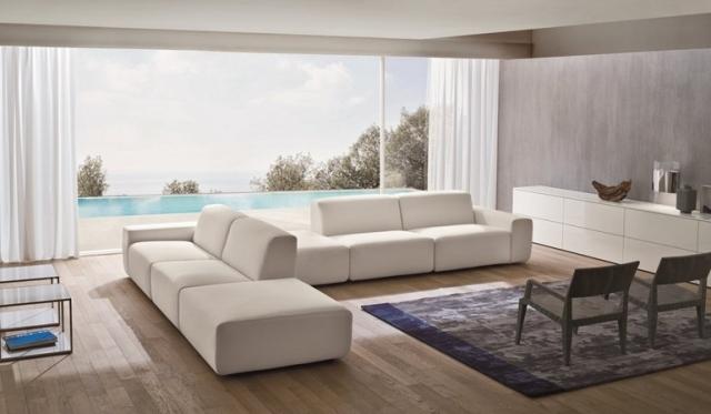 soggiorno moderno stile minimal divani bianco pavimento laminato effetto legno