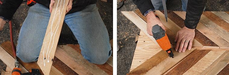 Tavoli fatti con bancali, uomo che incolla pezzi di legno con colla bianca