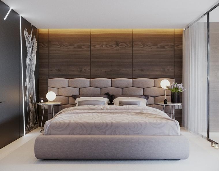 Zona notte con parete in legno, testata letto in tessuto, disegni sulle pareti