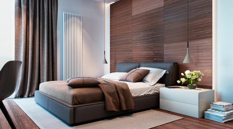 Zona notte con parete in legno, letto con testata in pelle, lampade in sospensione
