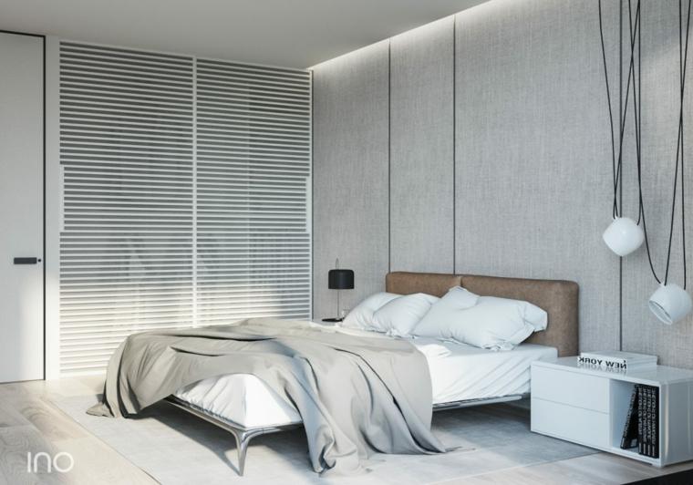 Soffitto con illuminazione led, testata letto in pelle, lampade in sospensione