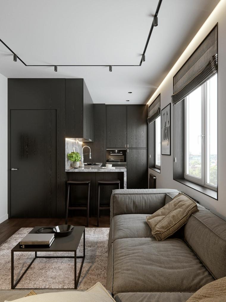 arredamento casa piccola open space cucina e soggiorno divano grigio con tavolino di metallo