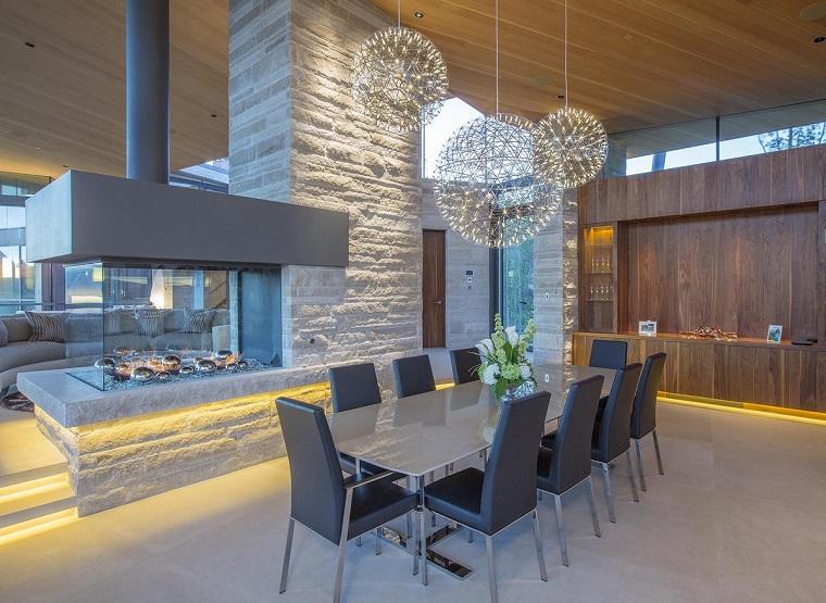 arredamento soggiorno elegante raffinato camino moderno vetro