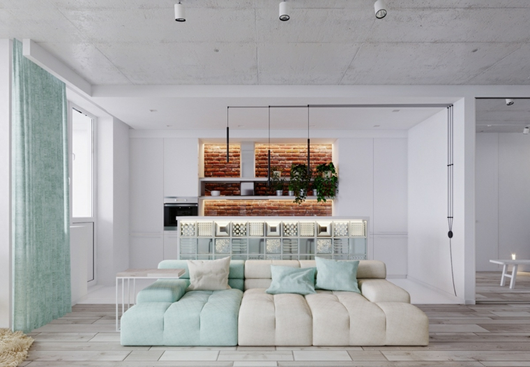 arredare appartamento piccolo salotto con divano bicolore illuminazione con faretti