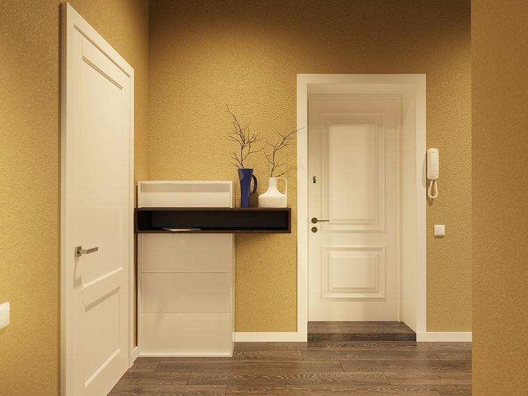 arredare corridoio ingresso pareti dipinte di giallo mobile scarpiera con mensola di legno