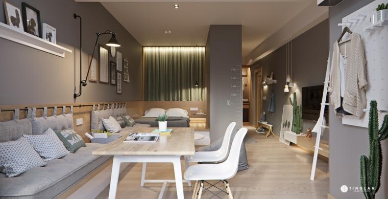 arredare mini appartamento soggiorno con divano grigio tavolo da pranzo di legno