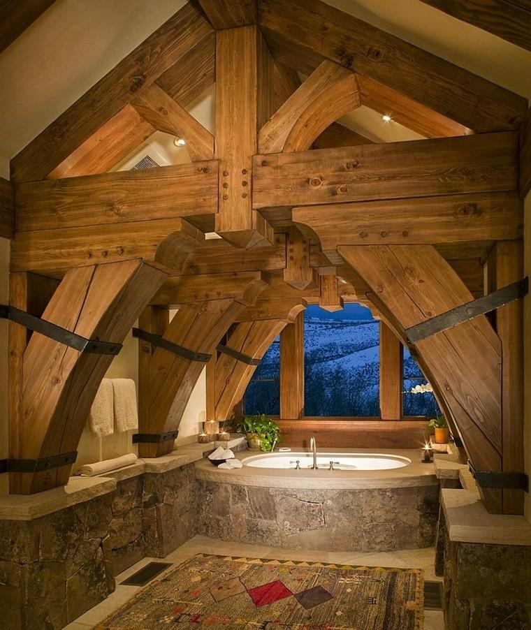 bagno arredato stile rustico vasca rivestita pietra