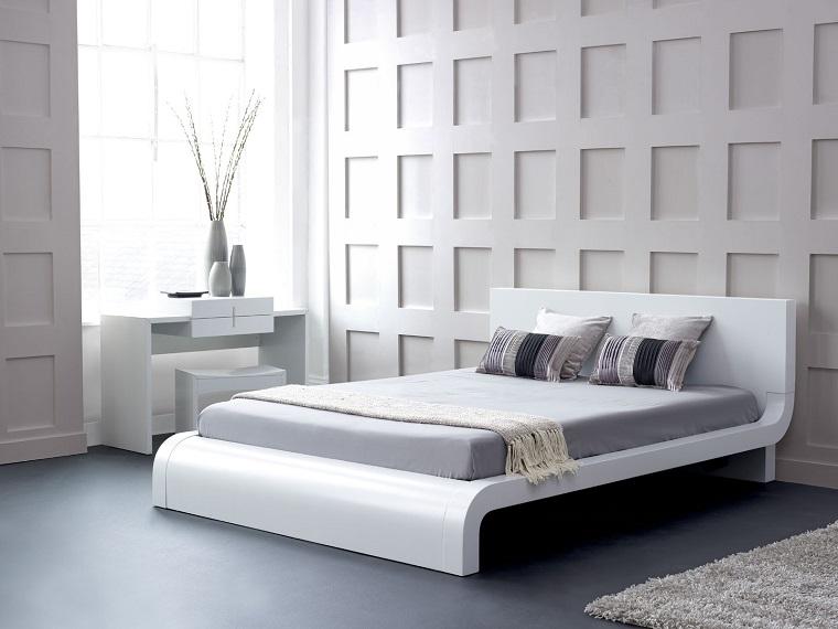 camera letto arredato mobili legno colore bianco