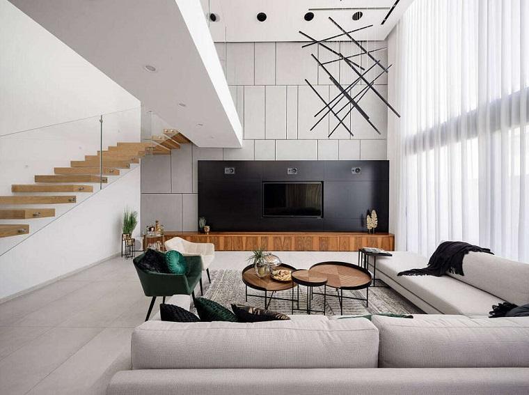 Soggiorno moderno, salotto con parete attrezzata con tv, tavolini bassi rotondi da caffè