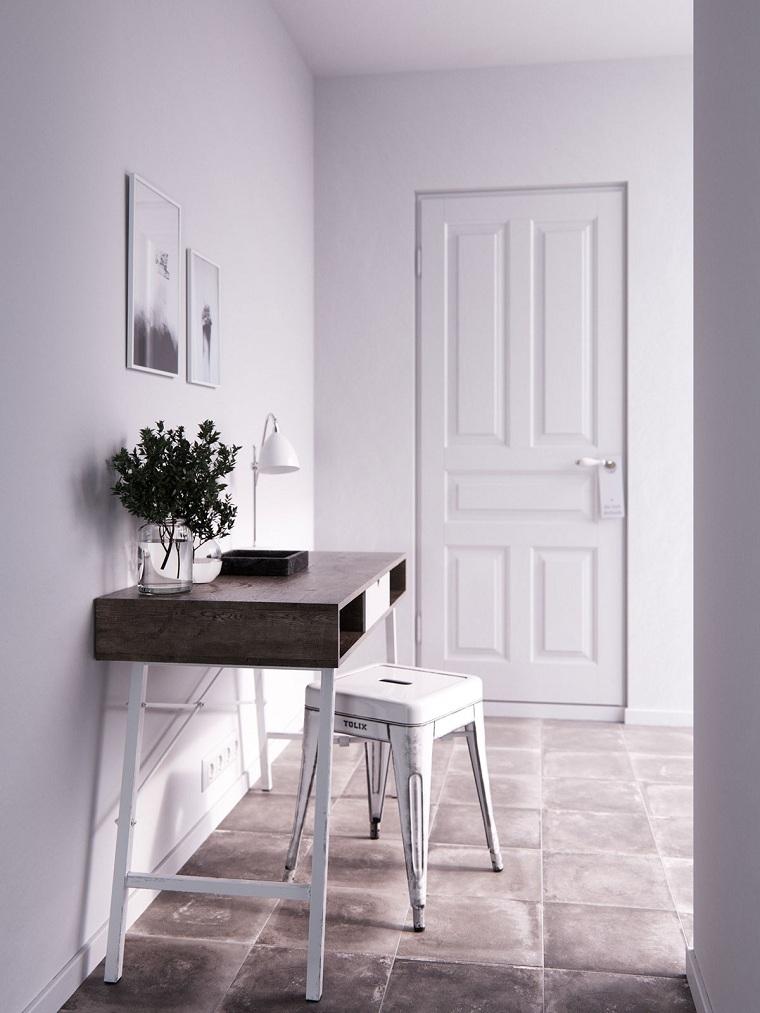 come arredare un ingresso piccolo e buoio mobile con sedia di legno corridoio con pareti bianche