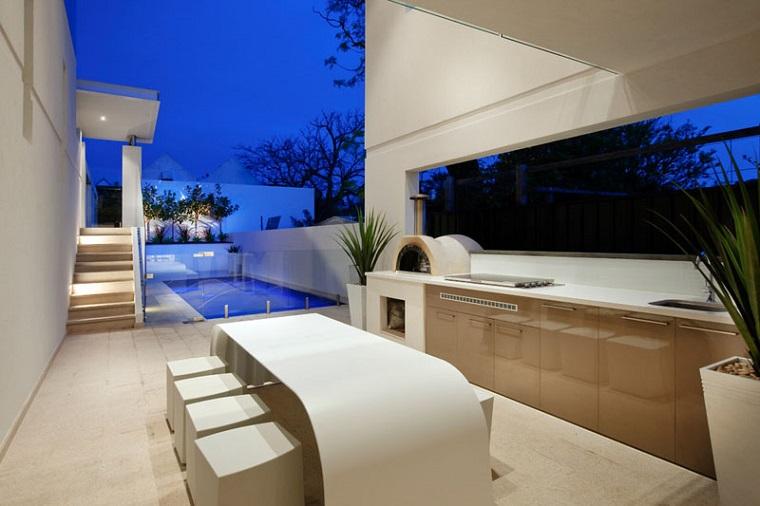 cucine da esterno soluzione design contemporaneo tavolo bianco