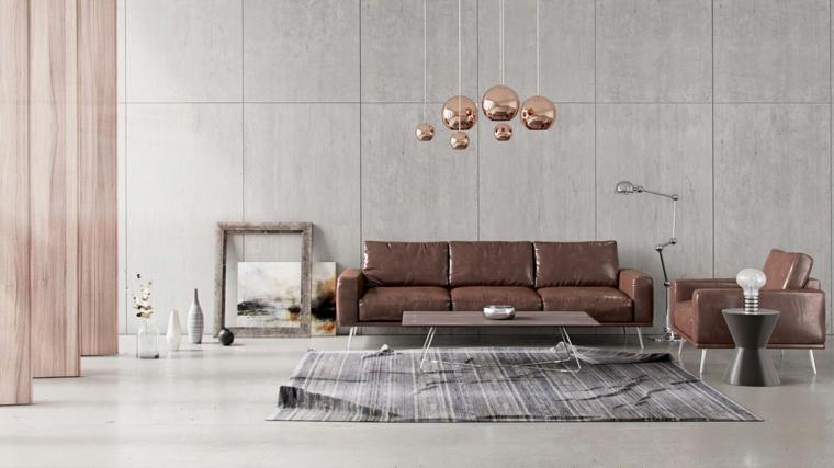 Soggiorno moderno, salotto con un divano di pelle, tavolino basso di legno, lampadari di rame sospesi