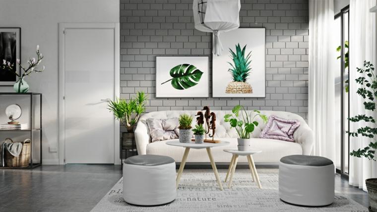 Soggiorno moderno, salotto con divano di colore bianco, tavolini da caffè con vasi di piante