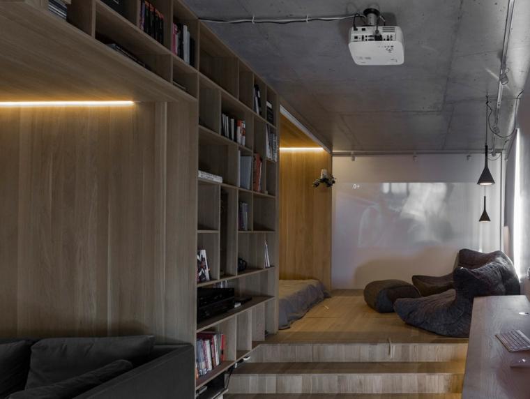 libreria di legno con scaffali aperti soggiorno con poltrone come arredare una casa piccola