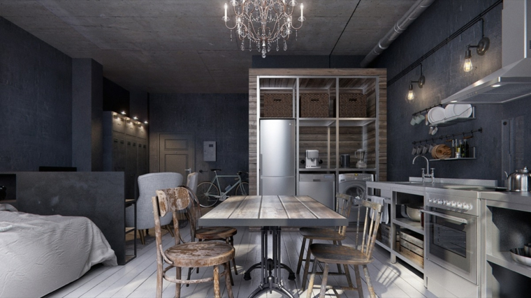 monolocale con cucina e salotto zona notte con letto tavolo da pranzo con sedie