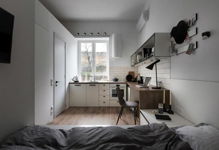monolocale con finestra arredamento casa piccola pareti bianche con mensole