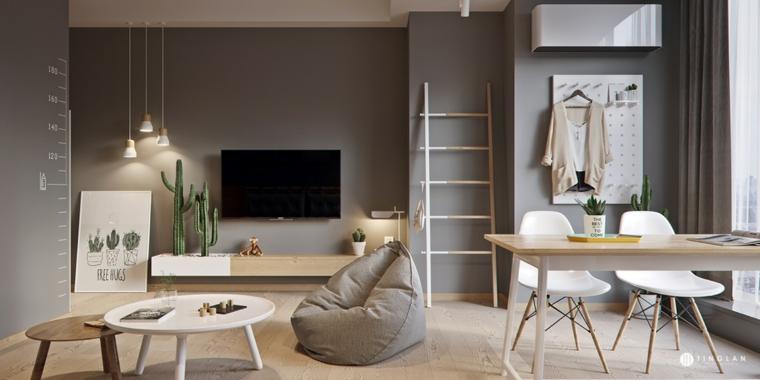 monolocale open space tavolini e poltrona pareti di colore grigio con tv appesa