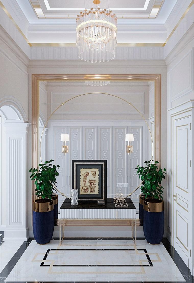 pannello appendiabiti da parete corridoio con grande specchio pavimento in marmo decorazione con vasi di piante