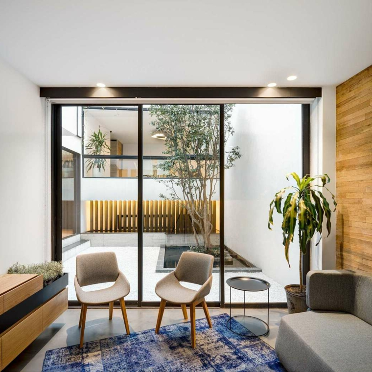 Soggiorni moderni componibili, salotto con due poltrone, soggiorno con tappeto di colore blu