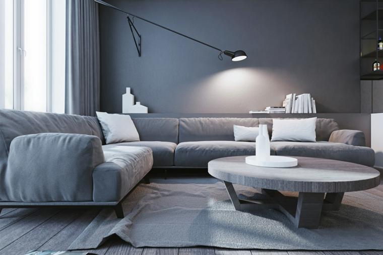 Esempi arredamento soggiorno, salotto con divano di colore grigio, parete dipinta di colore grigio
