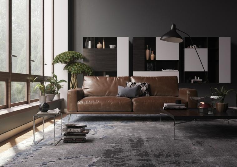 Esempi arredamento soggiorno, salotto con divano di pelle, mobile libreria in legno