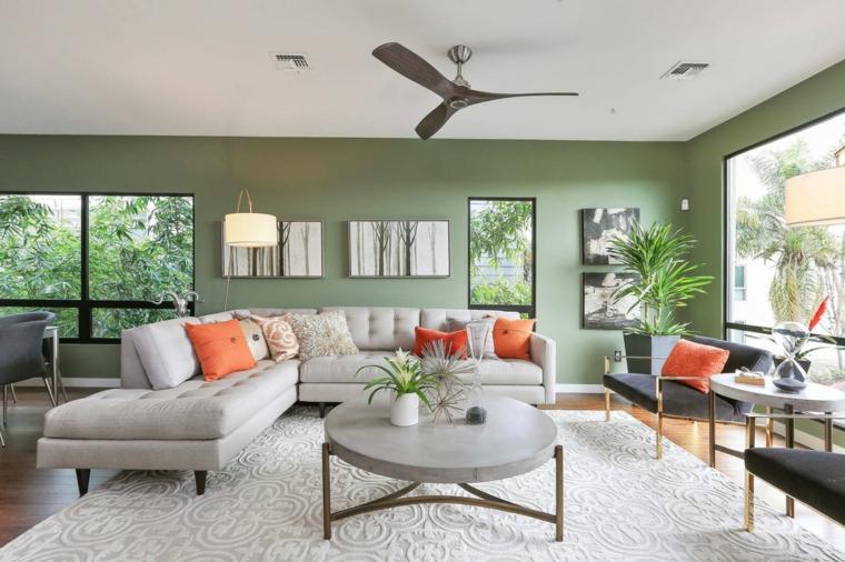 Come arredare sala e salotto insieme, divano angolare di colore grigio, tavolino basso rotondo per salotto