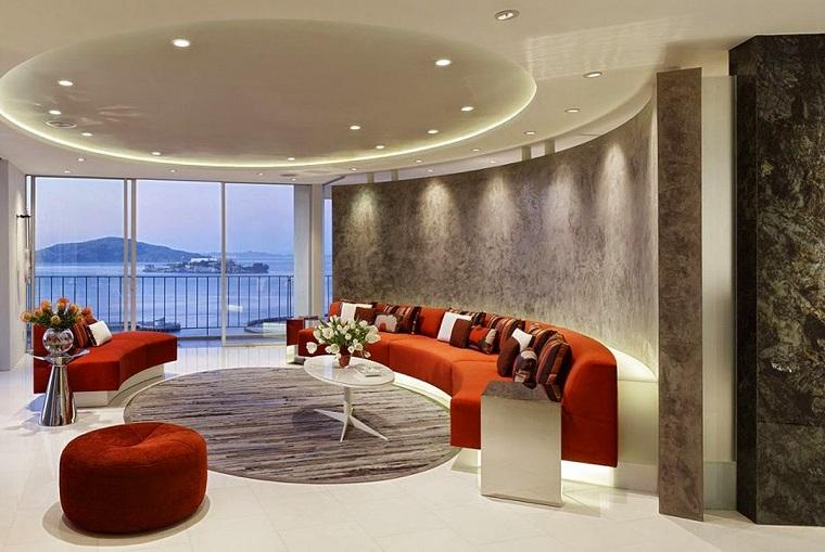 soggiorno moderno design futuristico divano circolare toni arancio