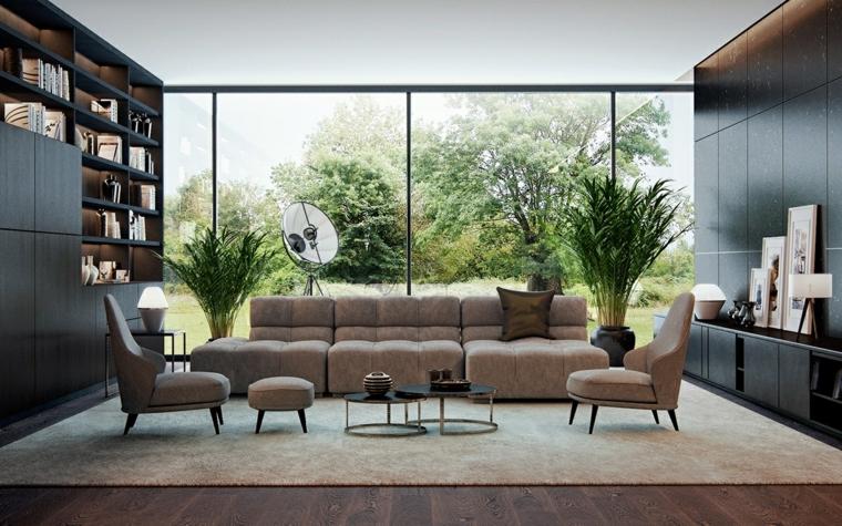 Salotto con divano in tessuto, parete con libreria integrata, soggiorno con tappeto grigio