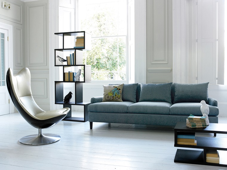 soggiorno moderno poltrona libreria design