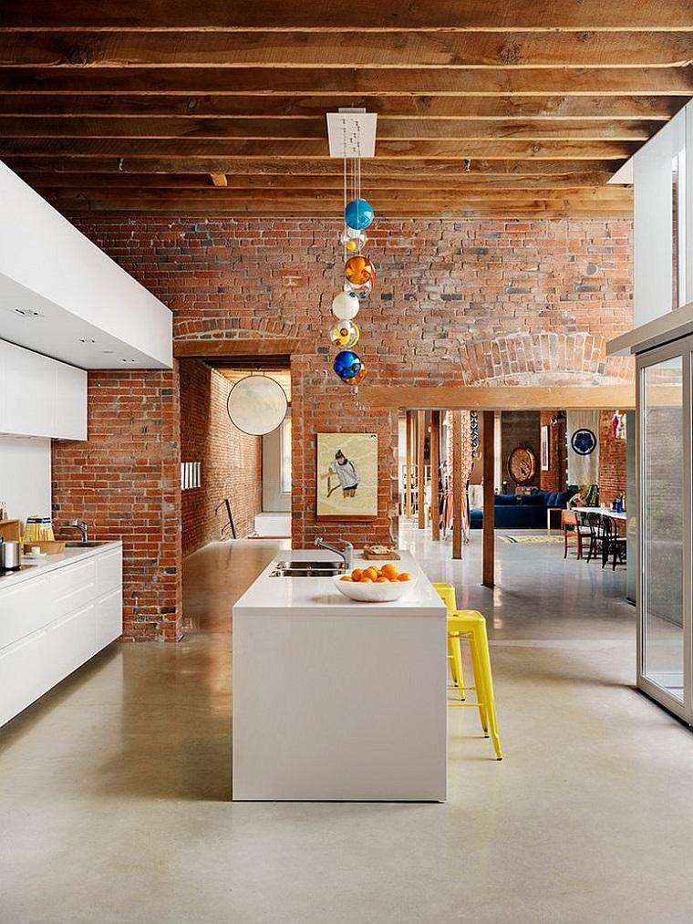 ambiente open space arredo cucina stile industriale