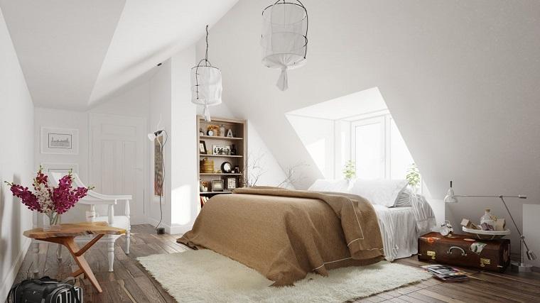 arredamento nordico camera letto tetto spiovente