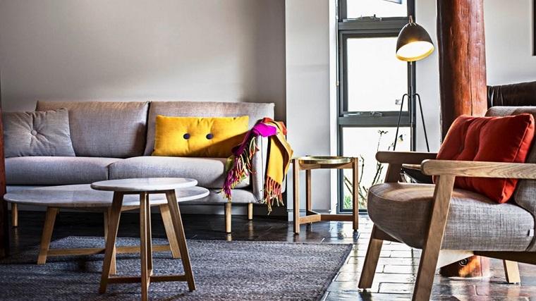 arredamento stile nordico salotto divani grigi