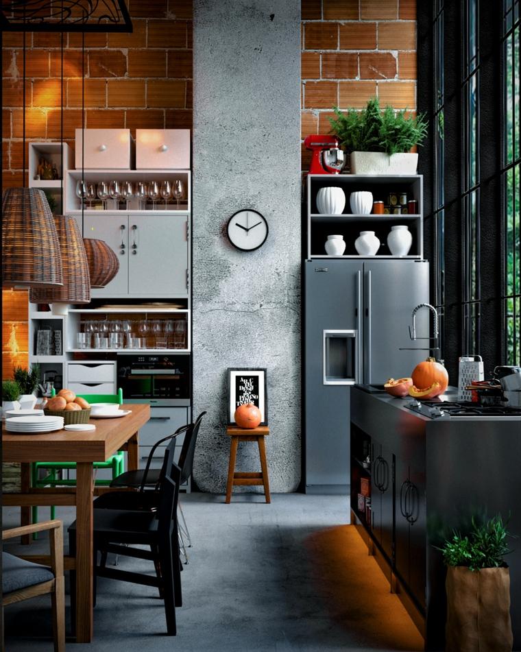 arredamento urban industrial cucina con elettrodomestici separati parete con mattoni a vista