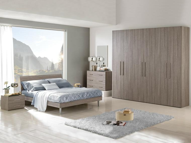 arredare casa moderna camera letto mobili legno tappeto