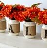 centrotavola-autunnale-vasetti-fiori-arancio