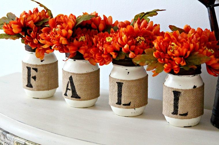 centrotavola autunnale vasetti fiori arancio