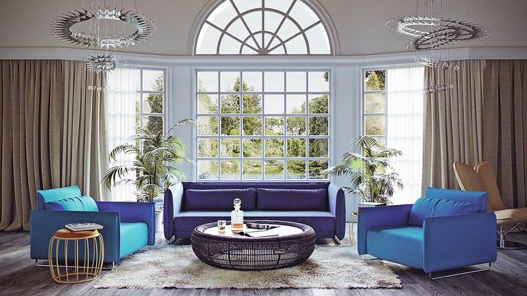 come arredare un soggiorno toanlita colore blu tavolino rotondo