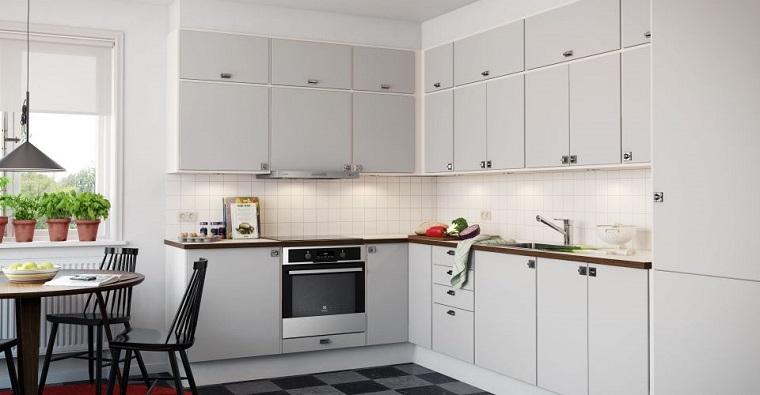 cucina angolare colore bianco stile classico tavolo legno