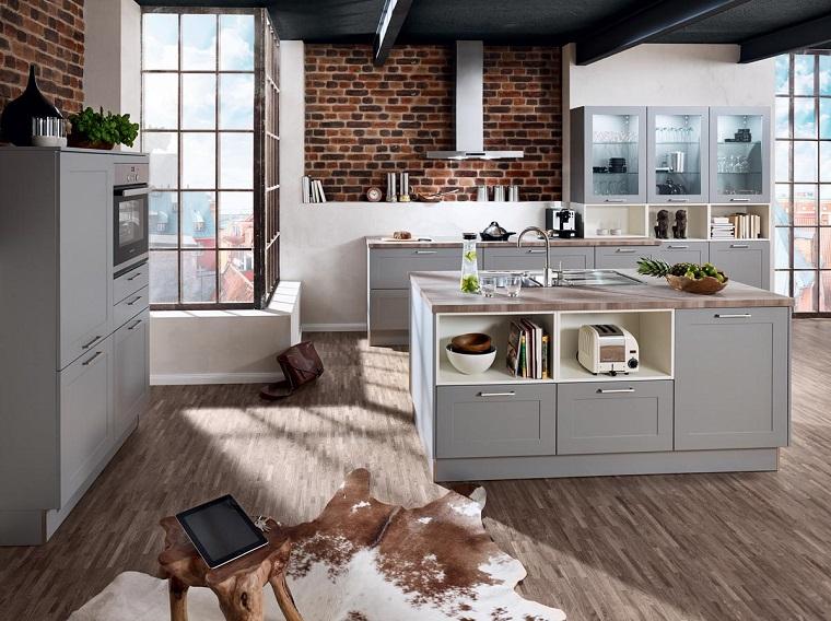 cucina vintage isola centrale parete mattoni vista design