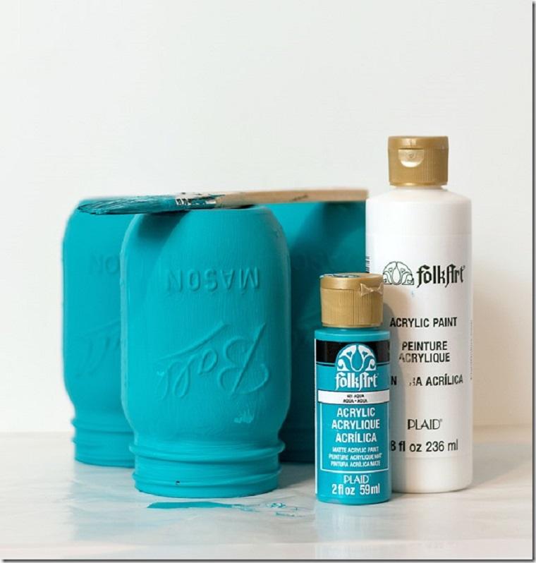 materiale per dipingere un barattolo bottiglie con vernice acrilica di colore blu