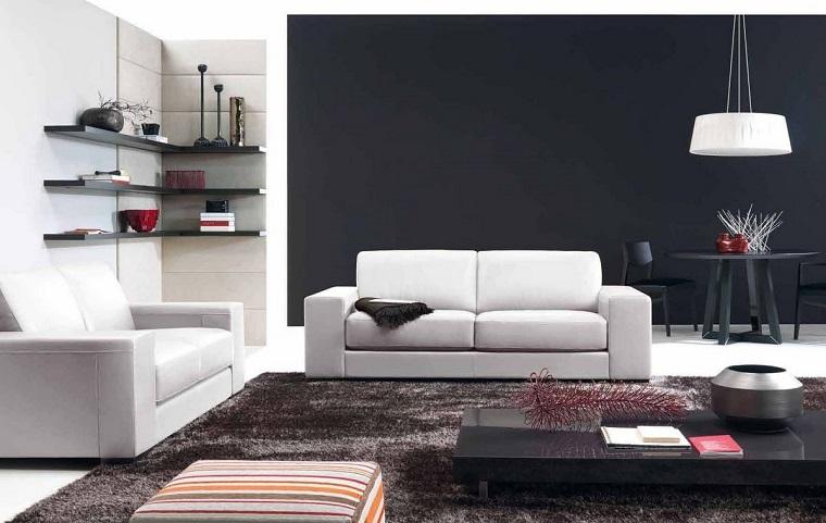mobili moderni salotto divani bianchi parete grigia scura