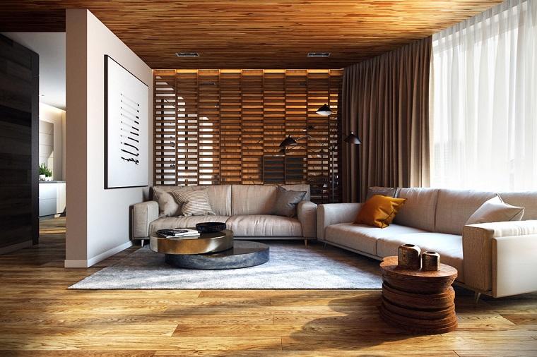 pavimento legno due divani tavolini legno quadro