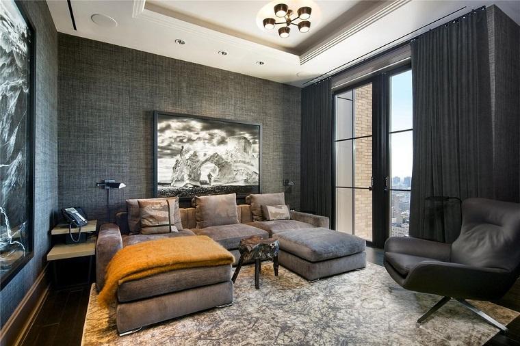 stile contemporaneo arredo soggiorno divano colore grigio soffitto illuminazione