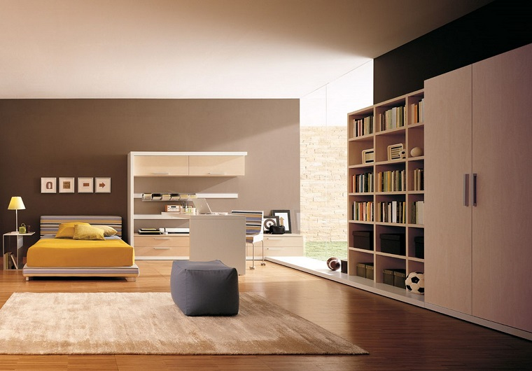 stile minimal arredo camera letto parete grigia