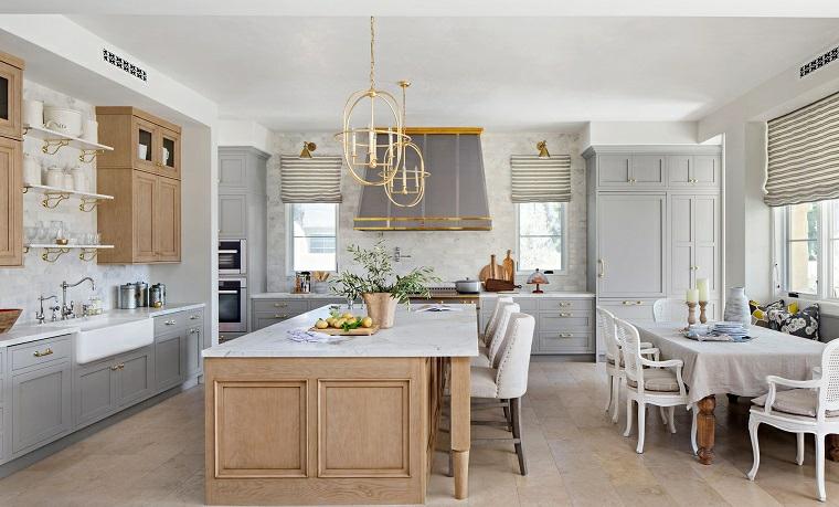 stile provenzale cucina isola centrale con top di marmo open space sala da pranzo