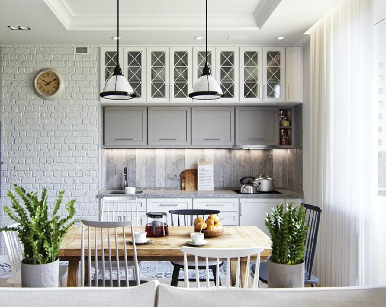 stile provenzale salotto cucina e sala da pranzo insieme mobili di legno colore chiaro