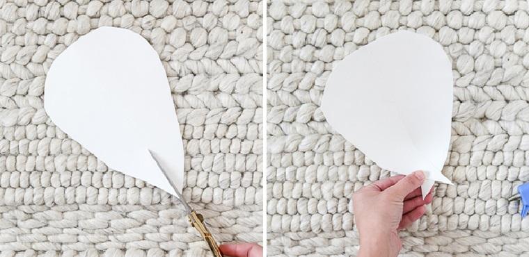 tagliare un petalo di carta con forbici tutorial per lavoretti di primavera decorazione