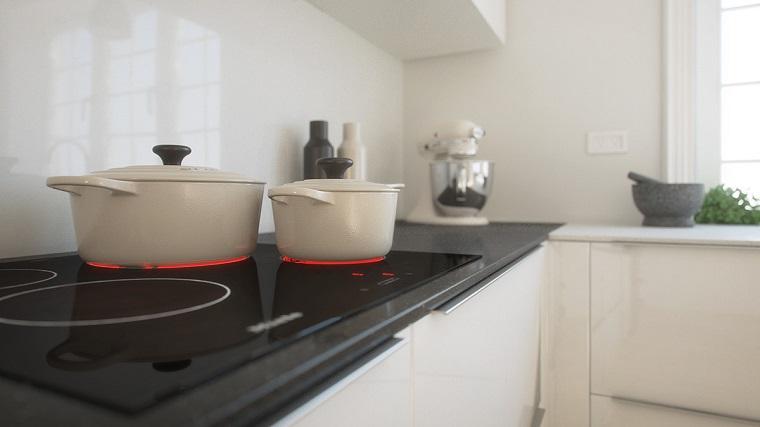 top nero di granito con fornelli cucine moderne bianche e lucide
