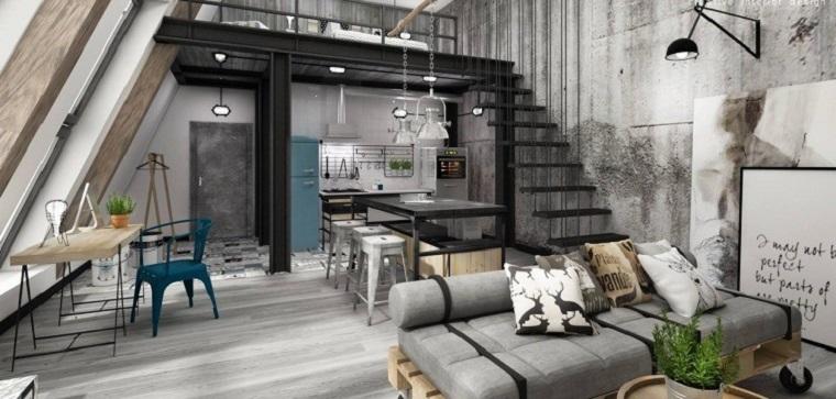 Mobili stile industriale, open space cucina e salotto insieme, soppalco con scale interne