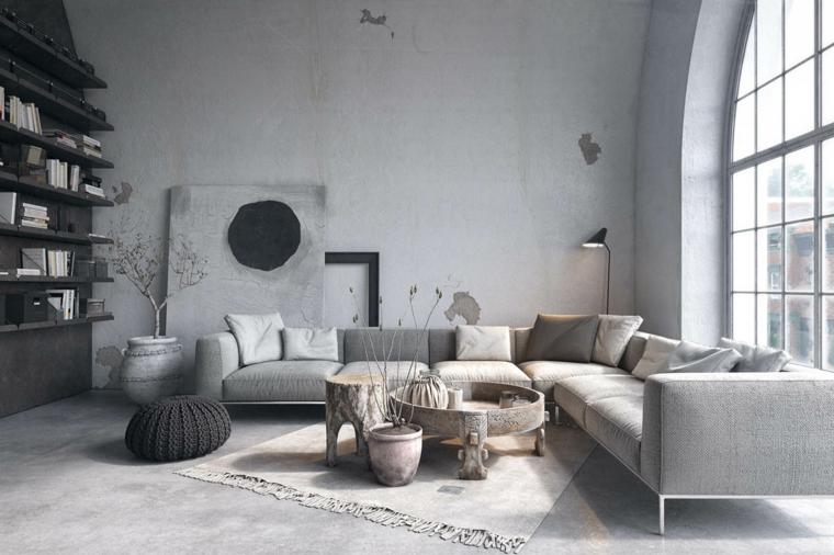 Soggiorno parete in cemento, mobili industriali vintage, divano angolare e tavolino basso